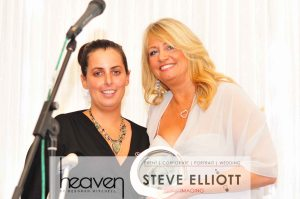 Jen Spahmer Cramer USA distributor pick`s up Heaven award on Camano Island Inn`s behalf.